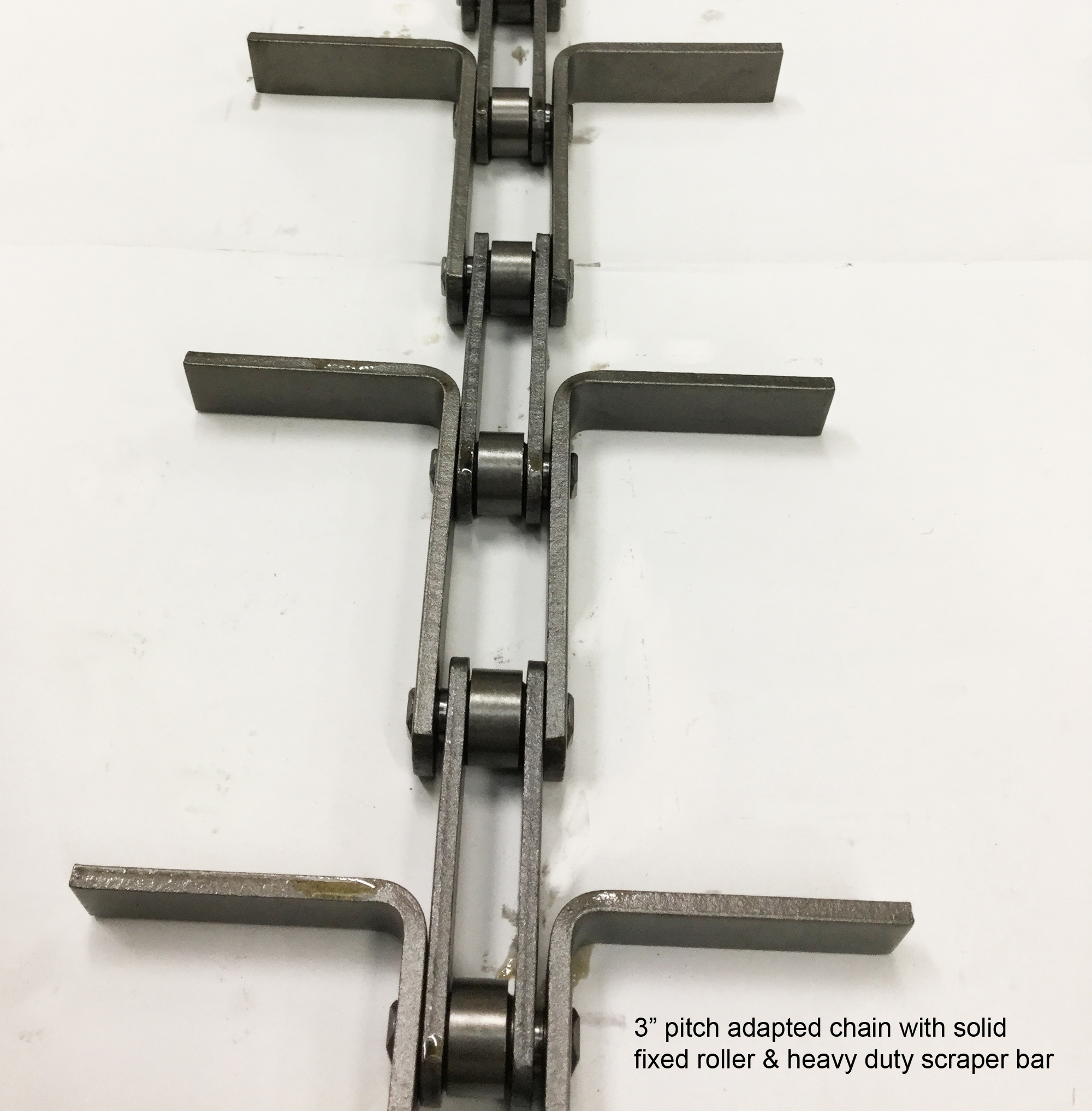 "3"" pitch adapted chain with solid fixed roller & heavy duty scraper bar feature."